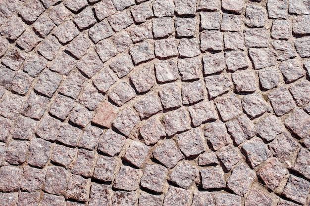 Abstrakter hintergrund der alten kopfsteinpflasterung