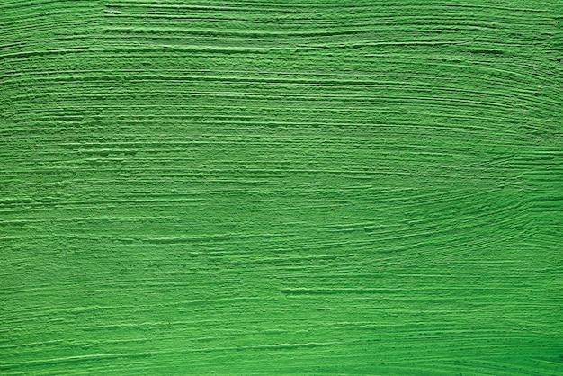 Abstrakter hintergrund der grünen farbe von acrylfarben. konkreter hintergrund.