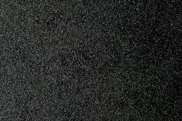 Abstrakter hintergrund der schwarzen leinwandbeschaffenheit mit leerzeichen für das hinzufügen von text und dekorativem design