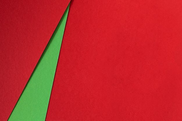 Abstrakter hintergrund des grünen und roten beschaffenheitspapiers