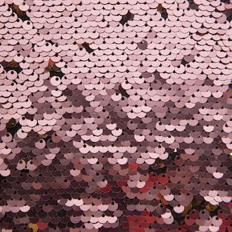 Abstrakter hintergrund des paillettengewebes