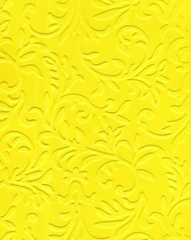 Abstrakter hintergrund des strukturierten musters des dekorativen papiers der gelben farbe oder des kartons
