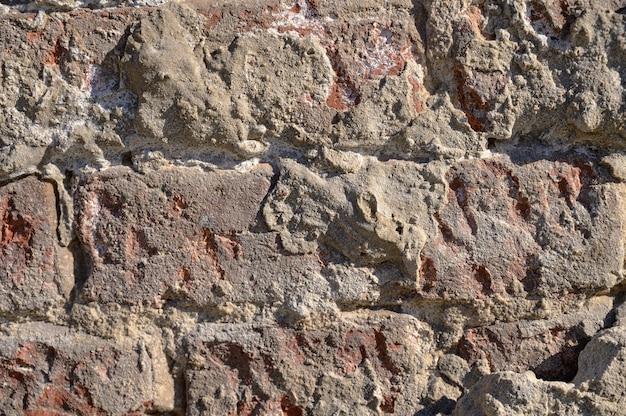 Abstrakter hintergrund einer alten roten backsteinmauer