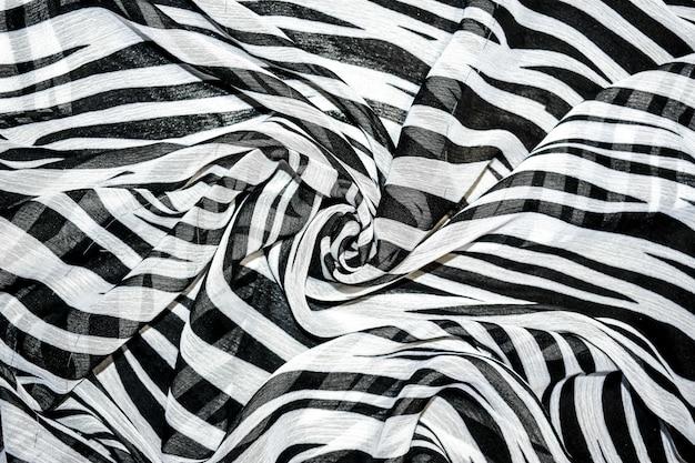 Abstrakter hintergrund in den schwarzweiss-streifen