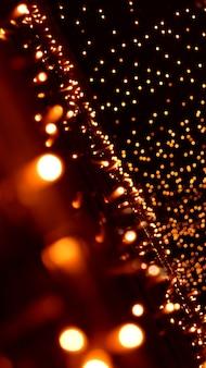 Abstrakter hintergrund mit gelb-orange goldenen lichtern