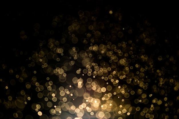 Abstrakter hintergrund mit goldbokeh. goldfunkeln und elegant für weihnachtshintergrund.