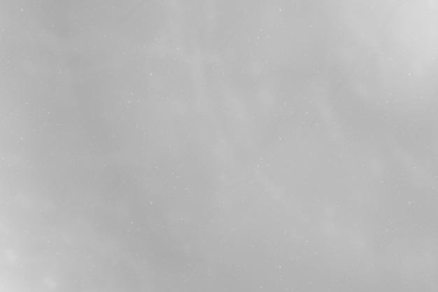 Abstrakter hintergrund mit textur in gedämpftem grau