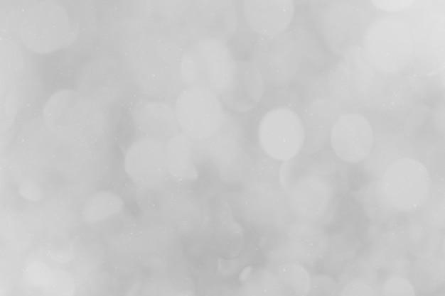 Abstrakter hintergrund mit trüben grauen bokeh-lichtern