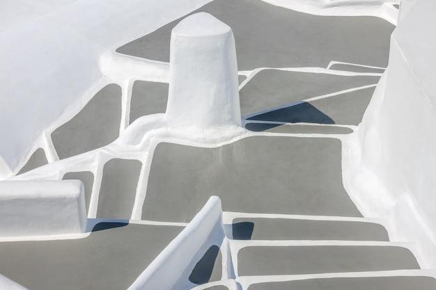 Abstrakter hintergrund mit vielen stufen der für santorini (thira) charakteristischen treppen in griechenland