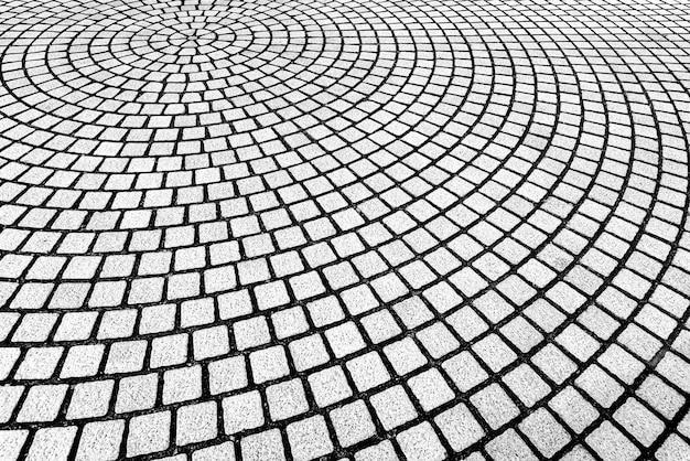 Abstrakter hintergrund vom maurerarbeitmuster verziert auf boden in der kurvenform.