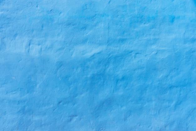 Abstrakter hintergrund von der blauen konkreten beschaffenheitswand.