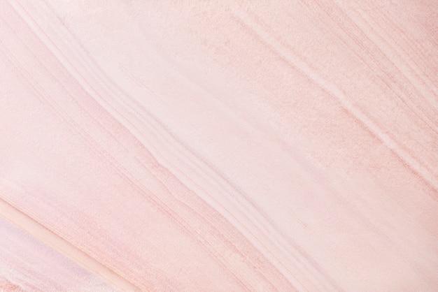 Abstrakter hintergrund von der rosafarbenen marmorbeschaffenheitsoberfläche im natürlichen licht.
