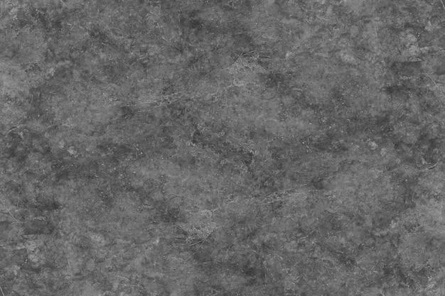 Abstrakter hintergrund von der schwarzen marmorbeschaffenheit auf wand