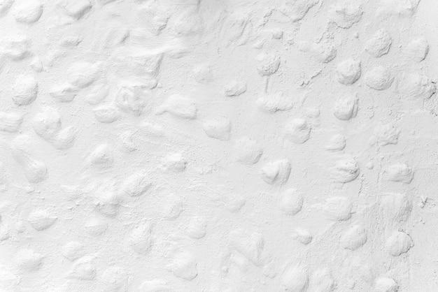 Abstrakter hintergrund von der ungleichen weißen wandbeschaffenheit dekorativ für tapete.