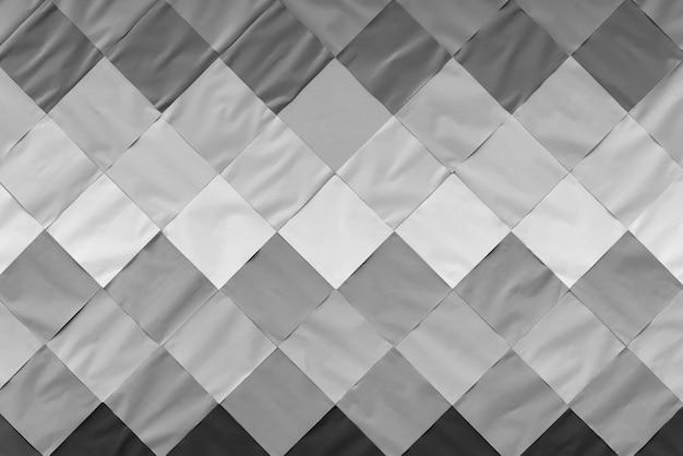 Abstrakter hintergrund von der weißen, grauen und schwarzen papiermusterdekoration auf wand.