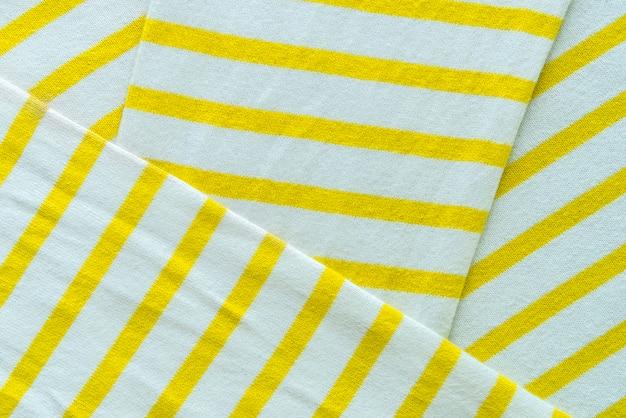 Abstrakter hintergrund von der weißen und gelben gewebebeschaffenheit