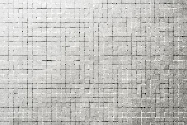 Abstrakter hintergrund von der weißen ziegelsteinmusterwand mit schmutz. vintage oder retro hintergrund.