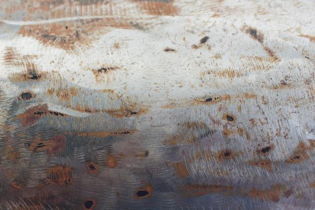 Abstrakter korrodierter bunter rostiger metallhintergrund, rostige metallbeschaffenheit.