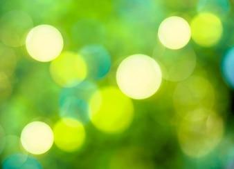 Abstrakter kreisförmiger grüner bokeh Hintergrund