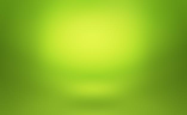 Abstrakter leerer raum des grünen farbverlaufs mit platz für ihren text und bild.
