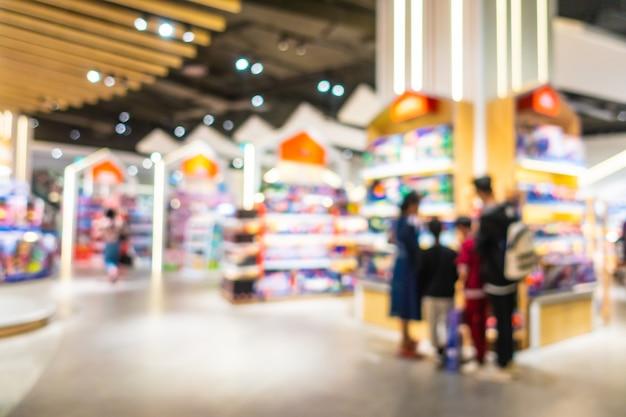Abstrakter luxuseinkaufszentruminnenraum der unschärfe und des defocus schöner, unscharfer fotohintergrund