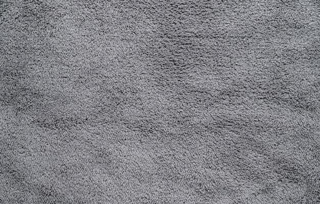 Abstrakter makro grauer stoffbeschaffenheitshintergrund