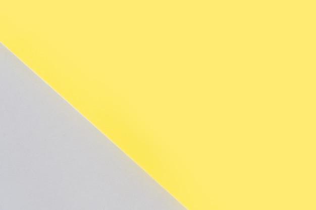 Abstrakter moderner handgemachter papierhintergrund in ultimativen grauen und leuchtenden gelben farben