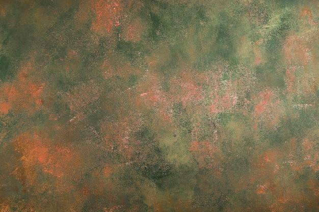 Abstrakter orange-grüner hintergrund mit weißen kratzern im schmutzstil. konzept für ihr design.