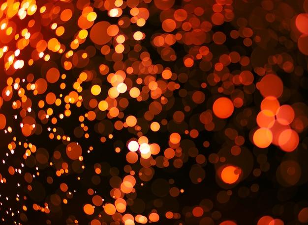 Abstrakter orange grunge weihnachtshintergrund. festlicher eleganter abstrakter hintergrund mit bokeh leuchten.