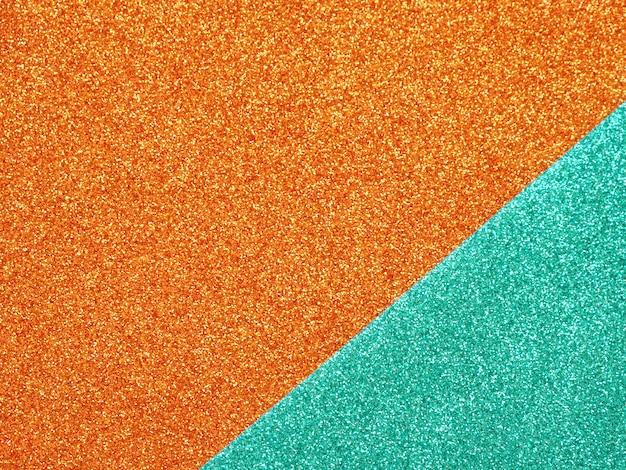 Abstrakter orange-türkis glter hintergrund.