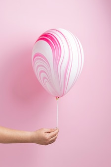 Abstrakter rosa festlicher ballon