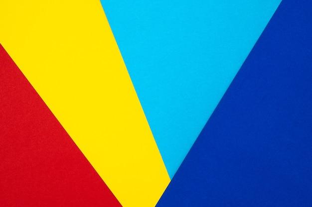 Abstrakter roter gelber und blauer geometriepapierbeschaffenheitshintergrund