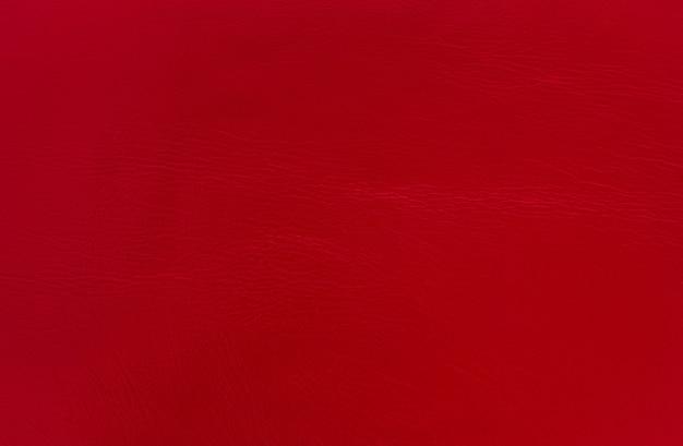 Abstrakter roter lederbeschaffenheitshintergrund