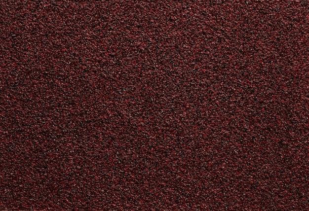 Abstrakter roter papiersandbeschaffenheitshintergrund