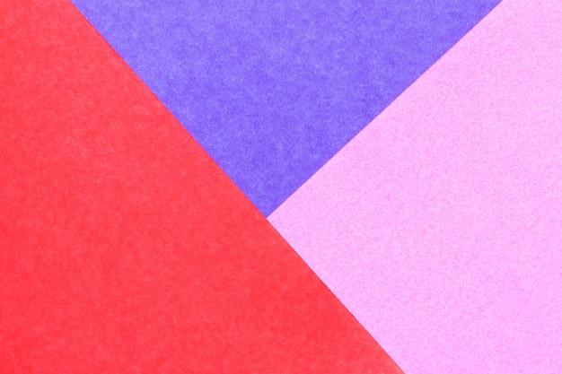 Abstrakter roter, rosa, blauer farbpapierhintergrund für design und dekoration