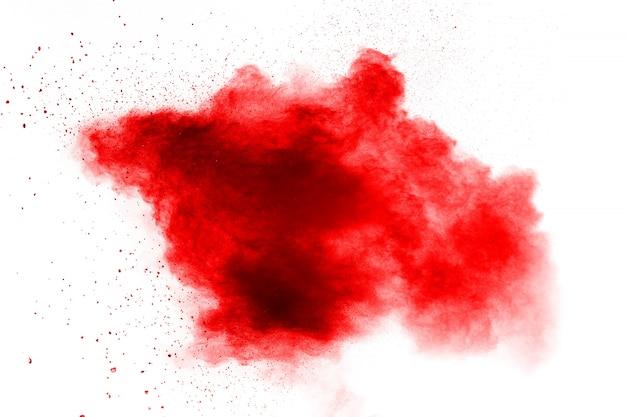 Abstrakter roter staub plätscherte auf weiß