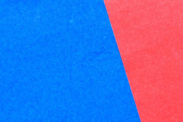Abstrakter roter und blauer farbpapierhintergrund für design und dekoration