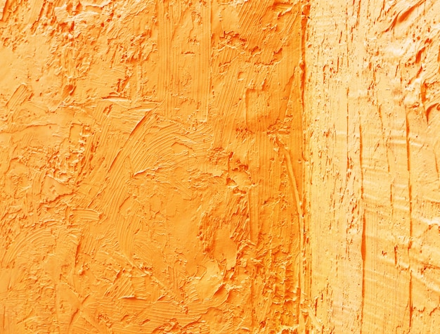 Abstrakter schmutzhintergrund mit gelber goldfarbezementwandszenenhintergrund.