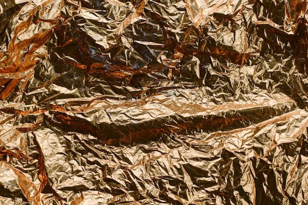 Abstrakter strukturierter goldener folienhintergrund