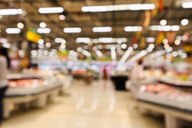 Abstrakter supermarktlebensmittelgeschäft verwischte defokussierten hintergrund mit bokeh-licht