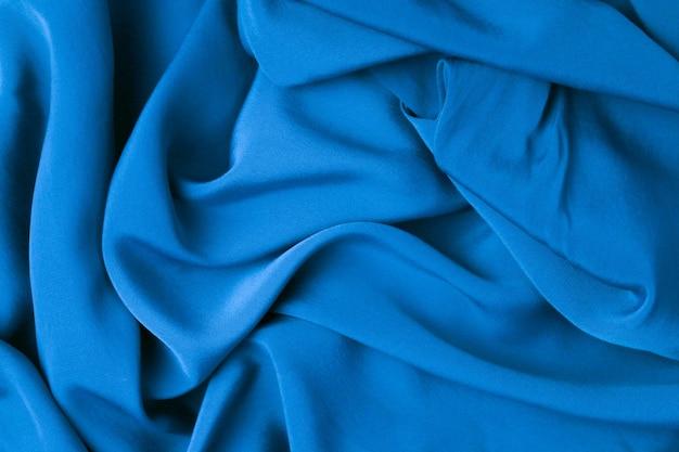 Abstrakter textilbeschaffenheitshintergrund der draufsicht