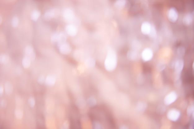 Abstrakter undeutlicher weicher rosa bokeh scheinnaturhintergrund
