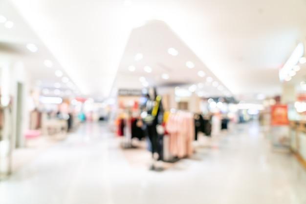 Abstrakter unschärfegeschäft und einzelhandelsgeschäft im einkaufszentrum für hintergrund
