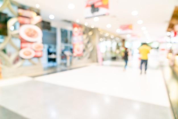 Abstrakter unschärfegeschäft und einzelhandelsgeschäft im einkaufszentrum für oberfläche