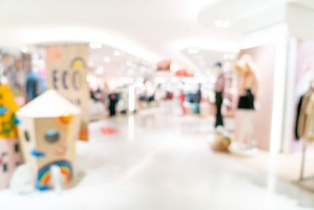 Abstrakter unschärfegeschäft und einzelhandelsgeschäft im einkaufszentrum