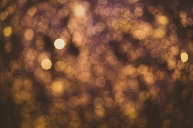 Abstrakter unschärfeglühbirnen-bokehhintergrund, winter- und weihnachtsbeleuchtungskonzept Premium Fotos