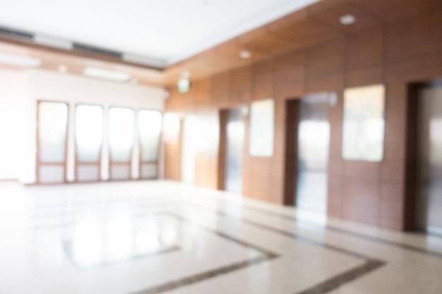 Abstrakter unschärfehotel und lobbyinnenraum