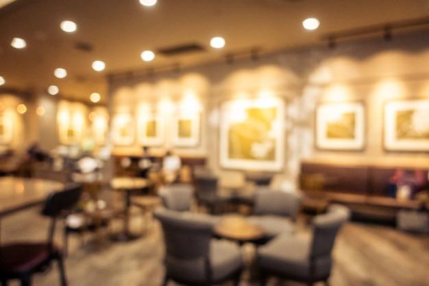 Abstrakter unschärfekaffeestube-caféinnenraum