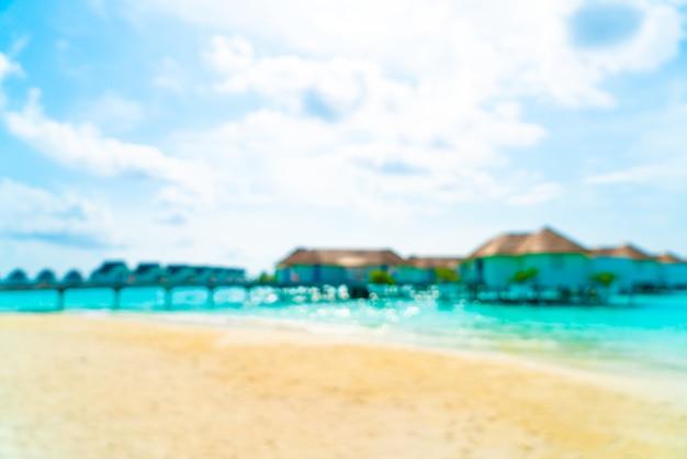 Abstrakter verwischter tropischer strand und meer in malediven für hintergrund