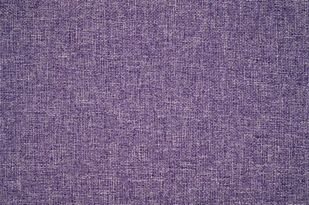 Abstrakter violetter stoffbeschaffenheitshintergrund